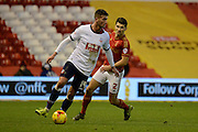 Nottingham Forest defender Eric Lichaj watches Bolton Wanderers striker Gary Madine during the Sky Bet Championship match between Nottingham Forest and Bolton Wanderers at the City Ground, Nottingham, England on 16 January 2016. Photo by Alan Franklin.