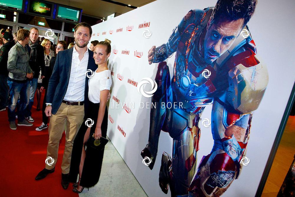 AMSTERDAM - In het Rai theater is de filmpremiere van Iron Man 3. Met op de foto  Kimberly Klaver en haar partner Bas Schothorst. FOTO LEVIN DEN BOER - PERSFOTO.NU