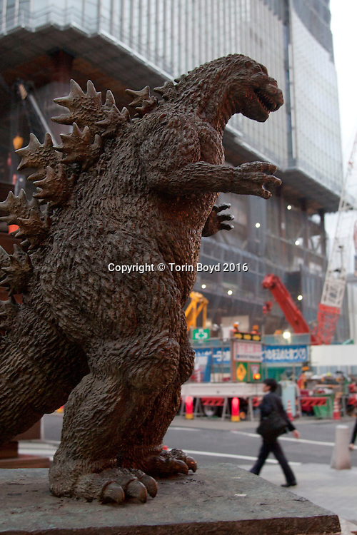 "July 20, 2016, Tokyo, Japan: This four foot high bronze Godzilla statue stands atop a pedestal at the center of Tokyo's Hibiya Chanter Square, where Japanese movie stars are paid tribute much like Hollywood's Walk of Fame. Erected in 1995 by Toho Co. Ltd. whose headquarters are located nearby, this plaza also includes castings of Japanese movie star handprints and signatures laid into the sidewalk. The first Godzilla sci-fi classic was released by Toho in 1954, but in 2004 the studio announced an end to the film series. Then in 2014, on the 60th anniversary of Godzilla film franchise, Toho announced production of a Godzilla ""re-boot"" slated for release in 2016. This new film titled ""Godzilla Resurgence"" (Japanese title ""Shin Godzilla"") was released nationwide in Japan on July, 29, 2016. It is the 29th Godzilla film made by Toho, but two other Hollywood production have also been made. (Torin Boyd/Polaris)."
