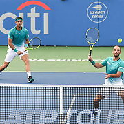 ROBERT FARAH and JUAN SEBASTION CABAL hit a volley at the Rock Creek Tennis Center.