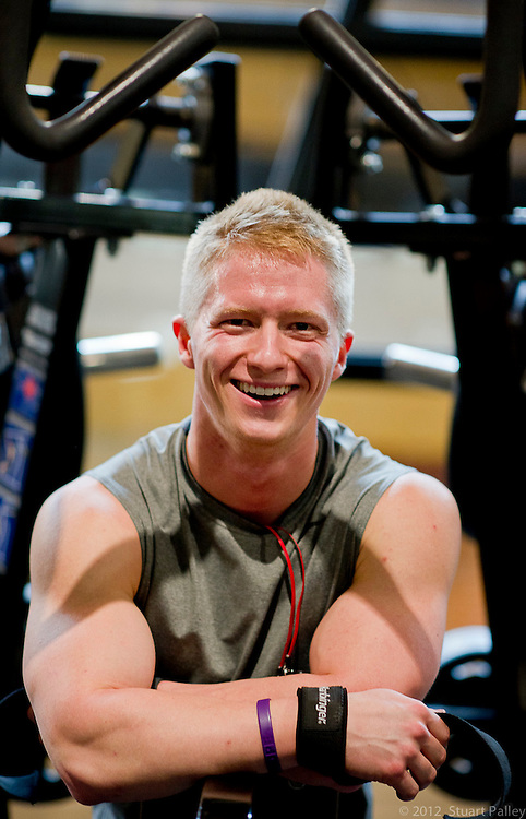 An environmental portrai of Logan in between sets on the lat pulldown machine. Logan McNeely is a Junior at the University of Missouri training for his first bodybuilding competition 45 days from now. Today Logan executed a solo back workout.