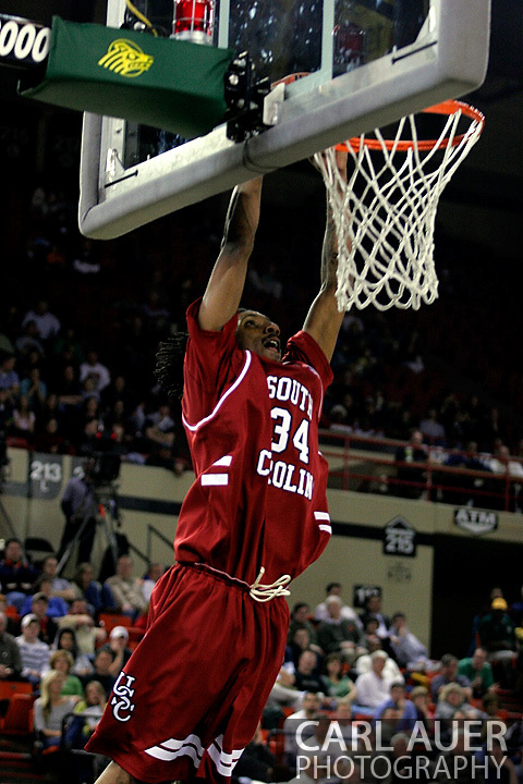 24 November 2005:Junior forward Renaldo Balkman (34) from the University of South Carolina elevates for a two handed dunk in the Gamecock's 65 - 60 victory over the University of Alaska Anchorage Seawolves in the first round of the Great Alaska Shootout at the Sullivan Arena in Anchorage Alaska.