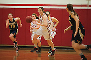 CVU's Laurel Jaunich (11) dribbles the ball down the court during the girls basketball game between the Essex Hornets and the Champlain Valley Union Redhawks at CVU high school on Tuesday night January 26, 2016 in Hinesburg. (BRIAN JENKINS/for the FREE PRESS)