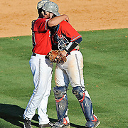 Mississippi pitcher Josh Laxer, left, and catcher Will Allen embrace at the end of an NCAA college baseball game against Arkansas in Oxford, Miss., Saturday, May 3, 2014. Mississippi won 7-4. (Photo/Thomas Graning)