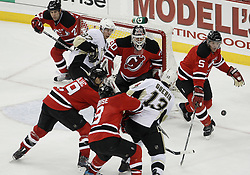 Dec 30, 2009; Newark, NJ, USA; New Jersey Devils defenseman Colin White (5) controls a loose puck while New Jersey Devils goalie Martin Brodeur (30) and Pittsburgh Penguins center Sidney Crosby (87) battle in front of the net during the third period at the Prudential Center. The Devils defeated the Penguins 2-0.