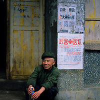 Elderly Man relaxes on doorstep, Yangshuo, Guilin, China