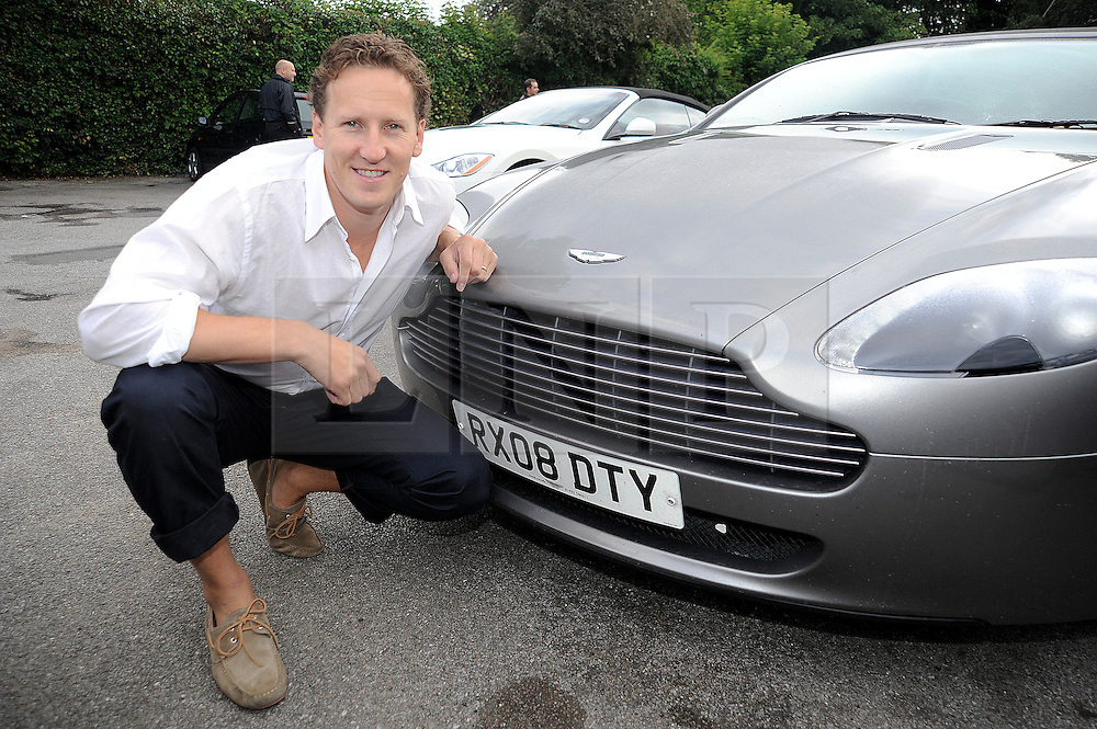 ©  licensed to London News Pictures. 10/06/2011. Cobham, UK. Brenden Cole with his Aston Martin getting ready for the The Supercar Challenge. Several cars worth more than £2 million in total left from the picturesque Leather Bottle pub, Cobham, for this third annual event which will see contestants take part in a series of challenges on the 1000 mile four day event. See special instructions for details. Picture credit should read Grant Falvey/LNP