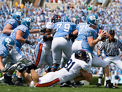 Virginia defensive end Chris Long (91) sacks North Carolina quarterback T.J. Yates (13).  The North Carolina Tar Heels football team faced the Virginia Cavaliers at Kenan Memorial Stadium in Chapel Hill, NC on September 15, 2007.  UVA defeated UNC 22-20.