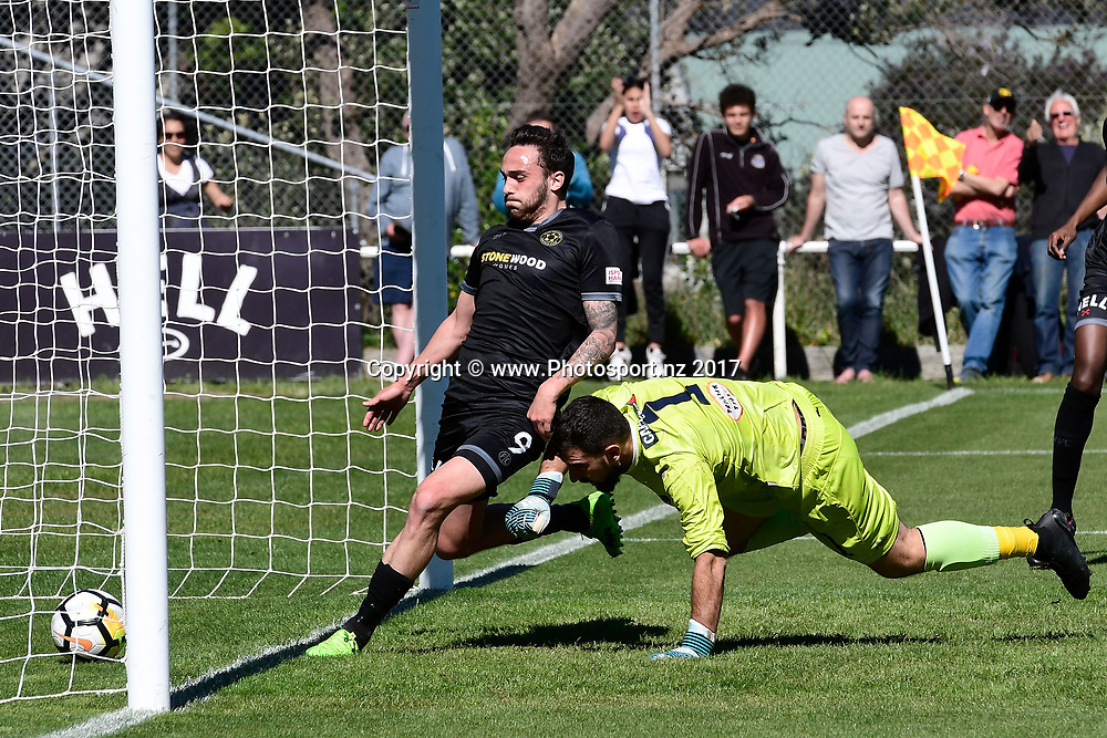 Team Wellington's Tom Jackson (L) finishes off a goal with Auckland's keeper Enaut Zubikarai (R during the ISPS Handa Premiership soccer game between Team Wellington and Auckland City at David Farrington Park in Wellington on Sunday the 15 October 2017. Copyright Photo by Marty Melville / www.Photosport.nz