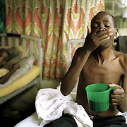 Elisha Unyango, 38, takes his daily cocktail of drugs to treat a TB infection at a hospital in Homa Bay, Kenya, Friday, December 15, 2000. TB infections in Kenya are rapidly increasing due to the spread of HIV/AIDS. In Homa Bay the infection rate is 30%. <br /> <br /> Photo by Lori Waselchuk