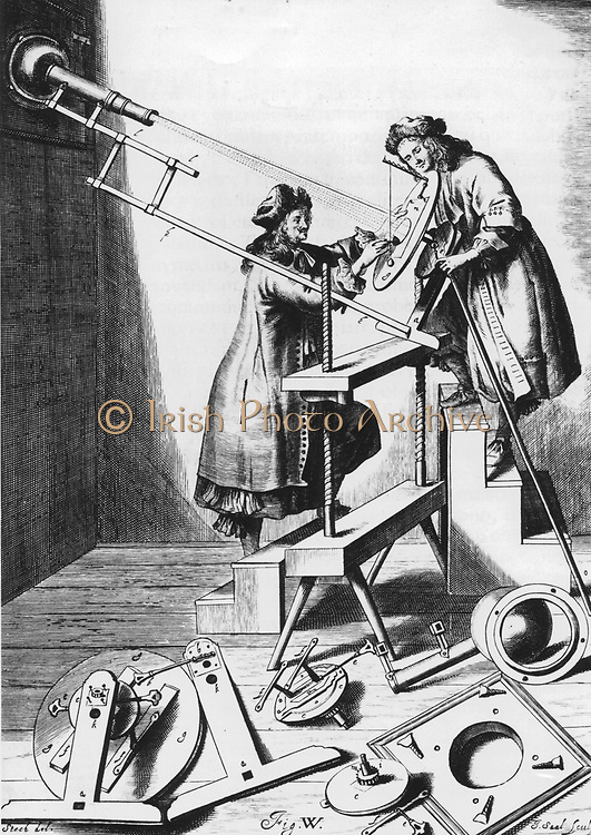 Observing a solar eclipse, 1673. Johannes Hevelius (1611-1687), a wealthy Polish brewer and councillor of Danzig devoted much time and money to astronomy. Hevelius, left, and an assistant, studying the sun during a partial eclipse. As viewing the sun directly would have damaged their eyes, they are in a darkened room and the sun's image is being projected  through a telescope onto a piece of white paper. From 'Machina Coelestis' by Johannes Hevelius. (Danzig, 1673).