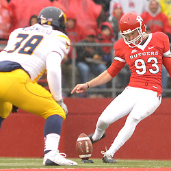 Dec 5, 2009; Piscataway, NJ, USA; Rutgers punter Teddy Dellaganna (93) kicks off during first half NCAA Big East college football action between Rutgers and West Virginia at Rutgers Stadium.
