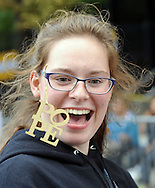 Rachel Prokopius, 18 of Highland Heights, Kentucky wears a pope artifact as she walks to the Festival of Families Saturday September 26, 2015 in Philadelphia, Pennsylvania. Pope Francis is expected to speak at the festival. (Photo By William Thomas Cain)