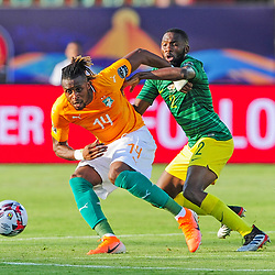 Jonathan Kodjia of Ivory Coast is challenged by Buhle Mkhwanazi of South Africa during the 2019 Africa Cup of Nations Finals game between Ivory Coast and South Africa at Al Salam Stadium in Cairo, Egypt on 24 June 2019  <br /> Photo : Icon Sport