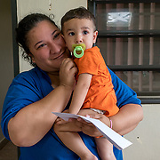 NOVEMBER 17, 2017&ndash;MARICAO, PUERTO RICO&mdash;<br /> Stephanie Colon Medina, 27, holding her one year old son Anthony Jaffeth. Colon Medina received a cash amount and water filtration system from Mercy Corps.<br /> (Photo by Angel Valentin)