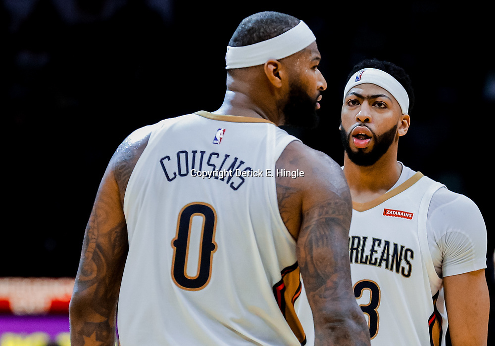 Jan 22, 2018; New Orleans, LA, USA; New Orleans Pelicans forward Anthony Davis (23) talks with center DeMarcus Cousins (0) during the double overtime against the Chicago Bulls at the Smoothie King Center. The Pelicans defeated the Bulls 132-128 in double overtime. Mandatory Credit: Derick E. Hingle-USA TODAY Sports