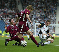 Photo: Andrew Unwin.<br /> Hearts v Gretna. Tennants Scottish Cup Final. 13/05/2006.<br /> Gretna's James Grady (R) slides in on Hearts' Robbie Neilson (C).