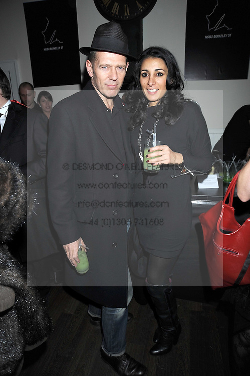 PAUL SIMONON and SERENA REES at a Halloween party hosted by Alexa Chung and Browns Focus held at the House of St.Barnabas, 1 Greek Street, London on 31st October 2008.