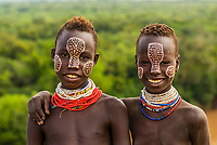 Teenage Kara tribe girls with face painting , Dus village, Omo Valley, Ethiopia.