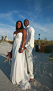 "Ashley Carnegie of Bradenton, Florida and Reginald Ward of Eustis, Florida, joined an assortment of other couples to wed on Lido Beach near Sarasota on June 19, 2010.  Infamous as being ""God's Waiting Room"", Sarasota, Florida, is a vibrant and dynamic city on the water complete with an impressive array of museums and cultural venues.  Along with, of course, beaches on the Gulf of Mexico."