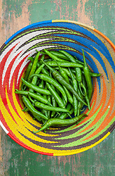 Chilli peppers in a colourful basket