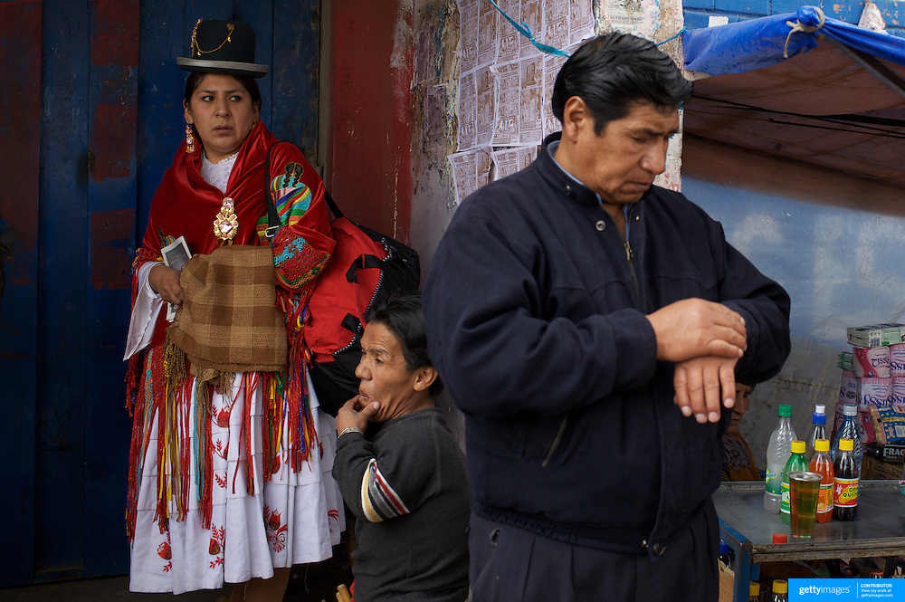 Cholita wrestler Martha La Altena waits for admission to the El Alto Multifunctional Centre, Bolivia where the 'Titans of the Ring' wrestling group perform each Sunday. The wrestling group includes the fighting Cholitas, a group of Indigenous Female Lucha Libra wrestlers who fight the men as well as each other for just a few dollars appearance money. El Alto, Bolivia, 24th January 2010. Photo Tim Clayton
