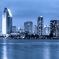 Panorama of blue San Diego skyline at night. San Diego is a major city in Southern California in the United States. Panoramic photo ratio is 1:3.