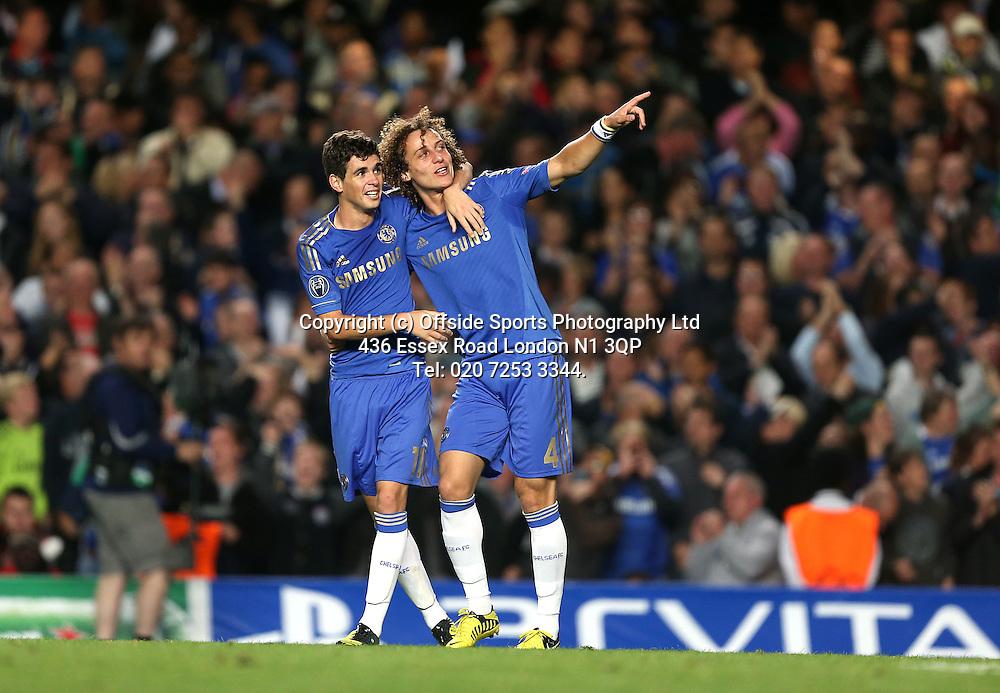 19 September 2012 Champions League football. Chelsea v Juventus.<br /> Chelsea Goalscorer Oscar with David Luiz (right).<br /> Photo: Mark Leech.