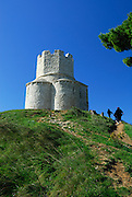 People climbing path to Saint Nicholas (Sveti Nikola) Church in the Prahulje field near Nin, Croatia