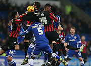 Gordon Greer, Brighton skippe, Rohan Ince, Brighton midfielder and Bruno Ecuele Manga battle for possession during the Sky Bet Championship match between Cardiff City and Brighton and Hove Albion at the Cardiff City Stadium, Cardiff, Wales on 10 February 2015.