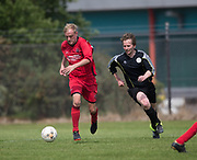 Hawkhill Athletic (red) v Dryburgh CC (black)  in the Dundee Saturday Morning Football League at University Grounds, Riverside, Dundee, Photo by David Young<br /> <br /> <br />  - &copy; David Young - www.davidyoungphoto.co.uk - email: davidyoungphoto@gmail.com