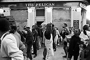 Crowd outside of a pub, Notting Hill Carnival, London, 1989