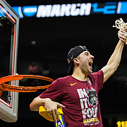 Loyola University Chicago junior Ben Richardson celebrates after beating Kansas State to advance to the Final Four in the NCAA Tournament at Philips Arena in Atlanta, GA., on March 24, 2018. (Photo: Lukas Keapproth)