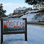 Merry Xmas written on snow covered sign, Seattle, Washington