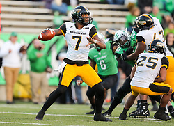 Nov 25, 2017; Huntington, WV, USA; Southern Miss Golden Eagles quarterback Kwadra Griggs (7) passes the ball during the third quarter against the Marshall Thundering Herd at Joan C. Edwards Stadium. Mandatory Credit: Ben Queen-USA TODAY Sports