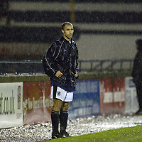 Raith Rovers v St Johnstone...29.11.03<br />Raith boss Antonio Calderon, a dejected figure in the rain as his side lose 4-1 to St Johnstone<br /><br />Picture by Graeme Hart.<br />Copyright Perthshire Picture Agency<br />Tel: 01738 623350  Mobile: 07990 594431