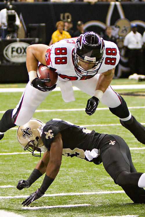 NEW ORLEANS, LA - NOVEMBER 11:  Tony Gonzalez #88 of the Atlanta Falcons jumps over Jabari Greer #33 of the New Orleans Saints at Mercedes-Benz Superdome on November 11, 2012 in New Orleans, Louisiana.  The Saints defeated the Falcons 31-27.  (Photo by Wesley Hitt/Getty Images) *** Local Caption *** Tony Gonzalez; Jabari Greer