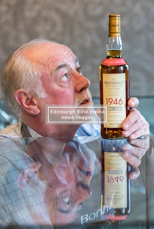 Auction house, Bonham's, will be holding a sale of rare whisky on 7 March 2018 at 11am. <br /> <br /> The sale includes two rare whiskies; a bottle of the Macallan Select Reserve 52 year-old 1946, bottled in May 1998. It is estimated at £12,000-14,000 and a bottle of Black Bowmore 1964, bottled in 1994, and estimated at £8,000-10,000. <br /> <br /> The 1946 Macallan was produced in an unusual way. Coal was scarce and expensive immediate after World War II, so the malt was dried in peat-fired kilns instead resulting in a whisky with distinct and complex tastes and aromas.<br /> <br /> Pictured: Danny McIlwraith of Bonham's with the Macallan 1946