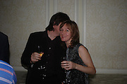 Fiona Rae and Dan Perfect. Art Review Dom Perignon Christmas dinner. Grosvenor Place. 14 December 2004. ONE TIME USE ONLY - DO NOT ARCHIVE  © Copyright Photograph by Dafydd Jones 66 Stockwell Park Rd. London SW9 0DA Tel 020 7733 0108 www.dafjones.com