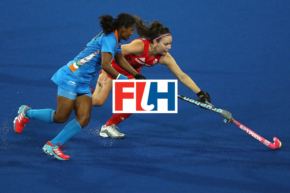 RIO DE JANEIRO, BRAZIL - AUGUST 08:  Poonam Rani #15 of India defends against Laura Unsworth #4 of Great Britain during a Women's Pool B match on Day 3 of the Rio 2016 Olympic Games at the Olympic Hockey Centre on August 8, 2016 in Rio de Janeiro, Brazil.  (Photo by Sean M. Haffey/Getty Images)