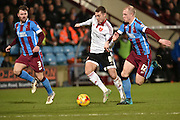 Sheffield United midfielder Paul Coutts under attack from Scott Laird of Scunthorpe United and Neil Bishop of Scunthorpe United  during the Sky Bet League 1 match between Scunthorpe United and Sheffield Utd at Glanford Park, Scunthorpe, England on 19 December 2015. Photo by Ian Lyall.
