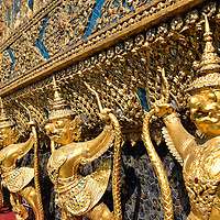 Row of Golden Garudas at Grand Palace in Bangkok, Thailand<br />