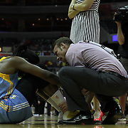 Chicago Sky Center SYLVIA FOWLES (34), left, gestures in pain while Chicago Sky medical staff examine FOWLES lower leg during the second half of an WNBA regular season basketball game between the Washington Mystics and the Chicago Sky Wednesday, July. 24, 2013 at The Verizon center in Washington DC.