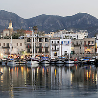 Girne, (Kyrenia) North Cyprus 19 April 2008 <br /> View of the old harbour of the city during the sunset.<br /> The Turkic Republic of Northern Cyprus (TRNC), commonly called Northern Cyprus, is a de facto independent republic located in the north of Cyprus. The TRNC declared its independence in 1983, nine years after a Greek Cypriot coup attempting to annex the island to Greece triggered an invasion by Turkey. It has received diplomatic recognition only from Turkey, on which it has become dependent for economic, political and military support. The rest of the international community, including the United Nations and European Union, recognises the sovereignty of the Republic of Cyprus over the territory of the TRNC.<br /> Photo: Ezequiel Scagnetti