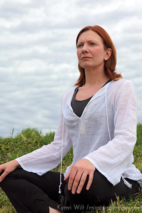 USA, California. Healthy natural mature woman sitting outdoors.