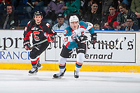 KELOWNA, CANADA - MARCH 1: Ryan Schoettler #16 of the Prince George Cougars back checks Rodney Southam #17 of the Kelowna Rockets on MARCH 1, 2017 at Prospera Place in Kelowna, British Columbia, Canada.  (Photo by Marissa Baecker/Shoot the Breeze)  *** Local Caption ***
