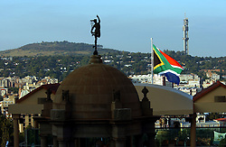 PRETORIA, SOUTH AFRICA - APRIL-27-2004 - The sun shines on the South African flag at the Union Buildings before the start of the inauguration ceremony for South African President Thabo Mbeki , which marks the 10th Anniversary of the fall of Apartheid in South Africa. (PHOTO © JOCK FISTICK)..<br />