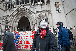 © Licensed to London News Pictures. 13/02/2012. London, UK. A member of the occupy movement wearing a Guy Fawkes mask outside The High Court on February 13th, 2012 in London, England. An appeal is being heard at the High Court today (13/02/2012) against a judgement handed down for the group's eviction from the protest camp brought by the City of London Corporation. Photo credit : Ben Cawthra/LNP