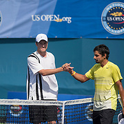 August 16, 2014, New Haven, CT:<br /> Sanam Singh and Jeff Dadamo shake hands after playing each other in the 2014 US Open National Playoffs Men's final on day four of the 2014 Connecticut Open at the Yale University Tennis Center in New Haven, Connecticut Monday, August 18, 2014.<br /> (Photo by Billie Weiss/Connecticut Open)