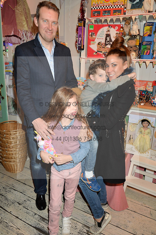 JAMES & LILY HODGES with their children JONATHAN and LOLA at a promotional party for the A Girl For All Time doll held at HoneyJam, 2 Blenheim Crescent, London on 5th December 2015.